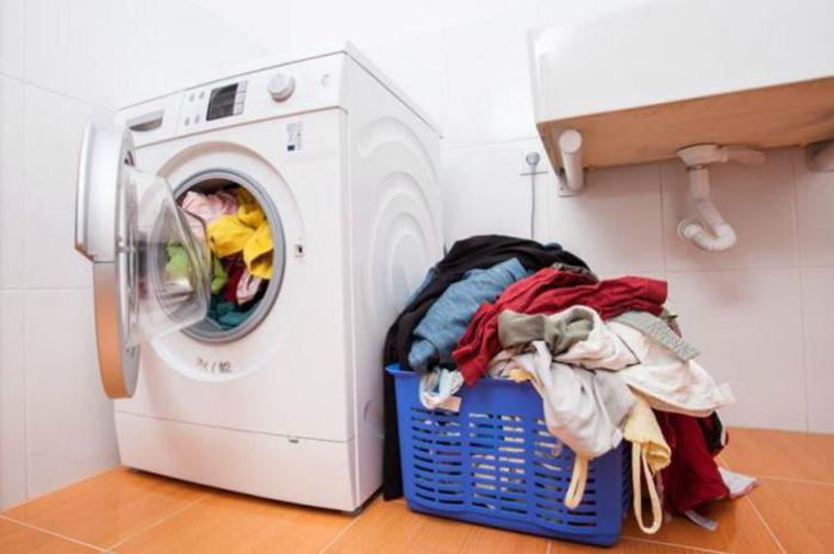 Không nhồi quần áo vào máy quá trọng lượng quy định